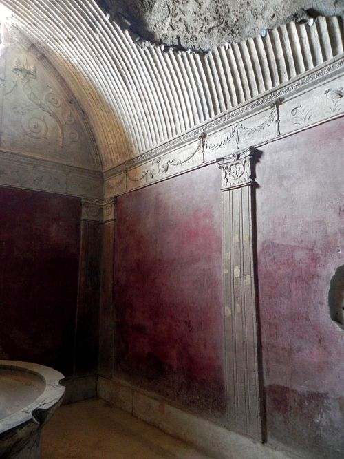 Caldarium (hot room) in the women's section with a basin, red walls