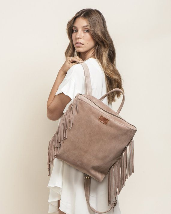 This handmade leather fringe backpack is A modern & chic convertible style and excellent go-to leather satchel. One top handle, 2 back straps which are