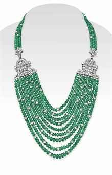 AN EMERALD BEAD AND DIAMOND NECKLACE The front designed as a multi-strand emerald bead swag, spaced by circular-cut diamond rondelles, intersected by two baguette and circular-cut diamond openwork plaques, to the three-strand emerald bead neckchain, joined by an openwork circular-cut diamond plaque clasp, mounted in white gold. Would love to make one for myself, challenge excepted!