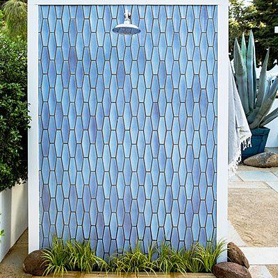 Replacement blue tile idea. Handmade tile from Heath Ceramics in San Francisco clad the outdoor shower in the Desert Modern garden.  http://www.heathceramics.com/