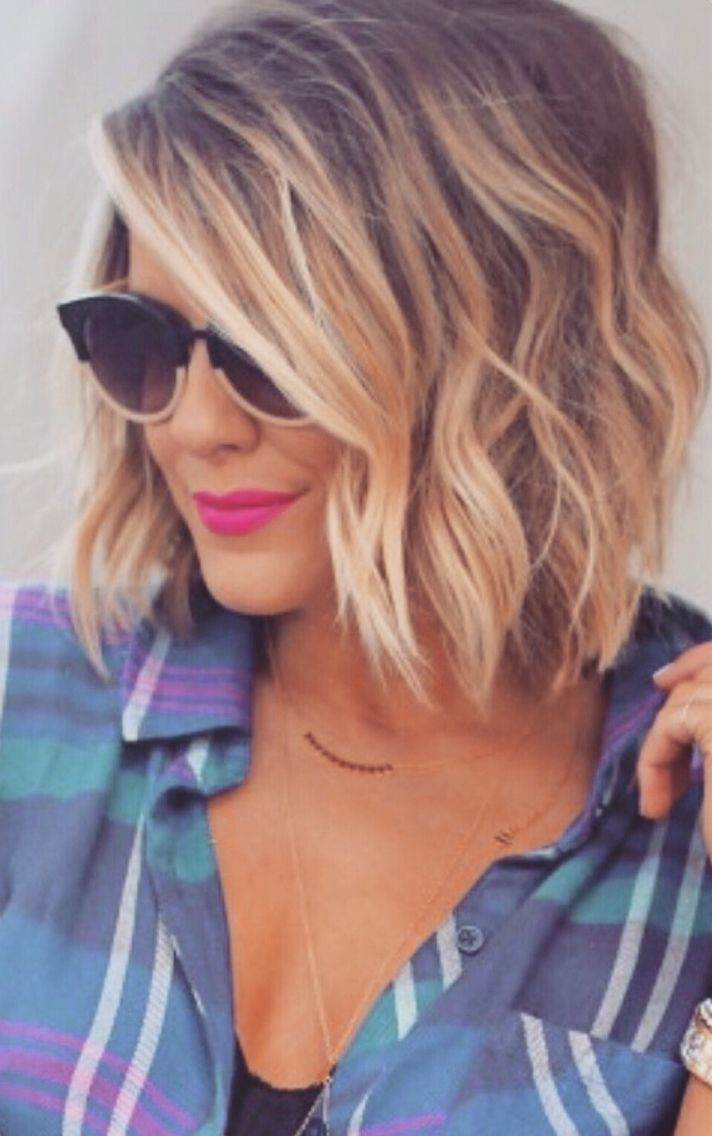 Gorgeous subtle tones in this short - midlength blonde hairstyle