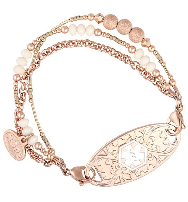 Kaye Medical ID Bracelet is a striking rose gold tone #medicalid with Swarovski crystals, rose gold beads, pearls, and stardust accents complemented by a rose gold tone chain. This eye-catching medical ID strand is sure to stand out for all the right reasons. (From $54.95) | Lauren's Hope
