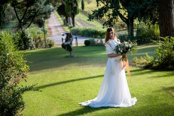 For tuscan wedding ceremony: hair down, loose and easy;  peach toned make-up. Bridal gown: Organic materials and understated modern designs  tell the story of vineyards carrying the perfume of the sea #altarosasposa