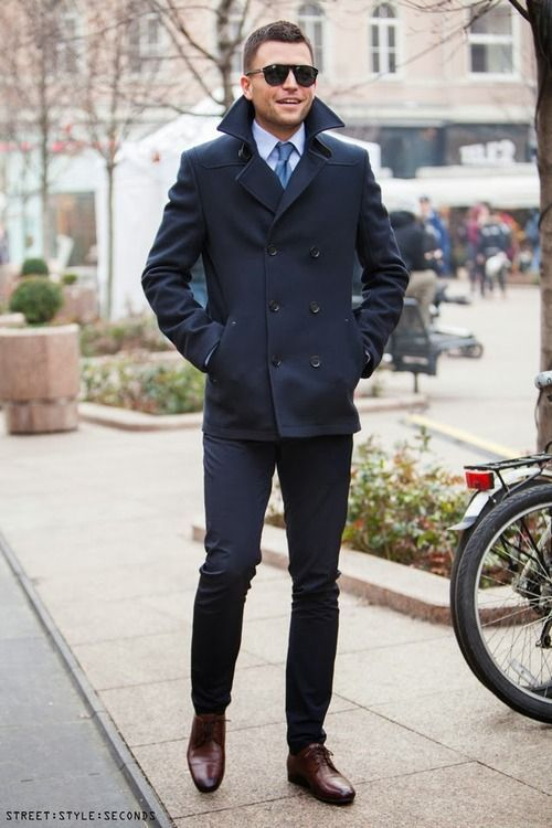 Shop this look for $264:  http://lookastic.com/men/looks/dress-shirt-and-tie-and-pea-coat-and-dress-pants-and-derby-shoes/3562  — Light Blue Dress Shirt  — Blue Silk Tie  — Navy Pea Coat  — Navy Dress Pants  — Dark Brown Leather Derby Shoes