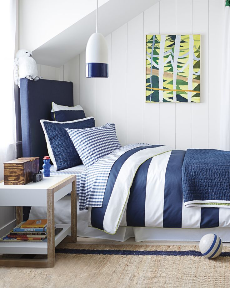 Ronan's crisp color combination recalls days by the sea and boats on the lake. Beachy navy/white rugby stripe with lime piping and button closures.