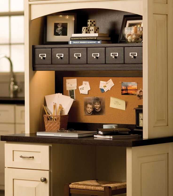 """Kitchen Message Center/Home Office: This #kitchen office #desk with Dura  Supreme #Cabinetry and apothecary drawers is shown with the """"Lancaster"""" cabinet door style in Quarter-Sawn Oak with """"Cocoa Brown"""" stained  finish and """"Antique White"""" paint and """"Espresso"""" glaze finish on Maple. – Find more ideas like this at DuraSupreme.com  #DuraSupreme #kitchendesk #homeoffice #kitchenremodel #messagecenter #desks"""