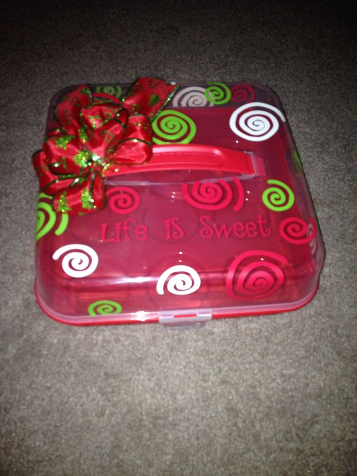 Cupcake carrier from the Dollar Store with vinyl decorations and wording.