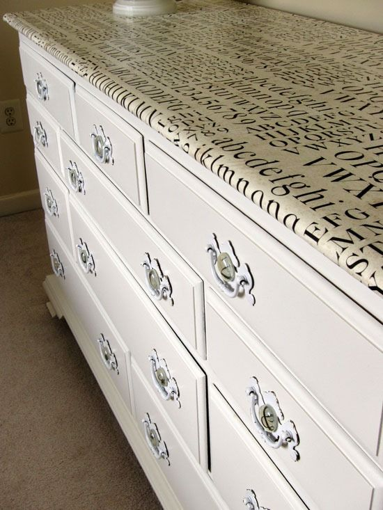 Furniture re-vamp using gift wrap and Modge Podge.