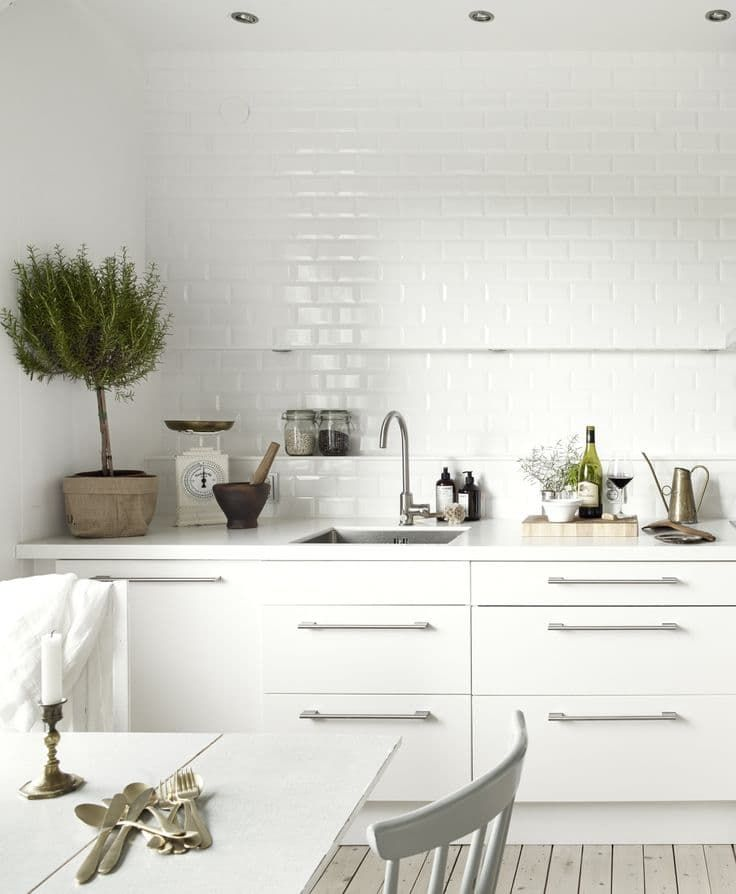 White cabinets & full wall of white subway tile | Beautiful & Surprising: 10 Unexpected Kitchen Details
