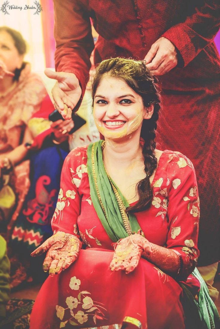 The gorgeous bride smiling and blushing at the haldi ceremony! Candid shots like these make us skip a beat.
