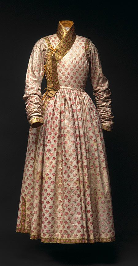The early Mughal Empire rulers Akbar and Jahangir were interested in fashion stuffs, carpets, and ornamental textiles. Both emperors enjoyed inventing new names for the garments they would wear. Akbar is recorded as having ordered a new coat or dress with a round skirt to be tied on the right side. This jama, from Burhanpur or Hyderabad, may be a later version of the Akbari garment. It is made of painted cotton, with the collars and seams in gold leaf. A truly lavish robe for any man.