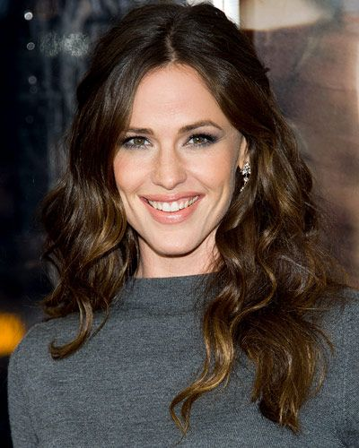 """STAY COOL TIP Most curls are too product-laden to look very luminous. Not Jennifer Garner's. """"Before styling Jen's hair, I used Frederic Fekkai Salon Glaze ($28, fekkai.com), which fills in the hair cuticle and really infuses shine,"""" says hairstylist Adir Abergel, who created the look. After the treatment, he allowed the hair to air-dry 80 percent of the way before finishing the blowout with a round brush. """"When I wrapped the hair around the curling iron, I made sure to curl the ends, too,""""…"""