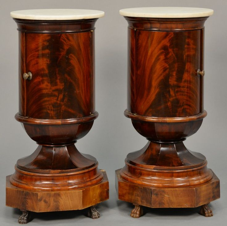 Pair of Empire round mahogany stands having marble tops over one door over octogon base resting on claw feet ~ Realized Price $7,500.00    #nadeausauction