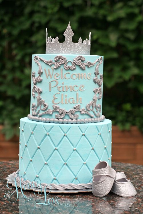 Royal baby shower cake for baby boy prince complete with crown and fondant baby shoes. Visit HoneyLove at www.HoneyLoveCakery.com and follow on FB, twitter, and instagram.