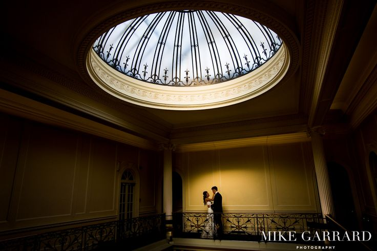 Beautiful bride and groom portrait under the exquisite glass dome at Hedsor House.