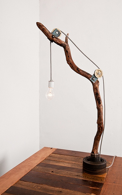 I made this lamp from various industrial parts and a fallen branch from a Madrona tree.  Please contact me for more info www.whitcombandcompany.com