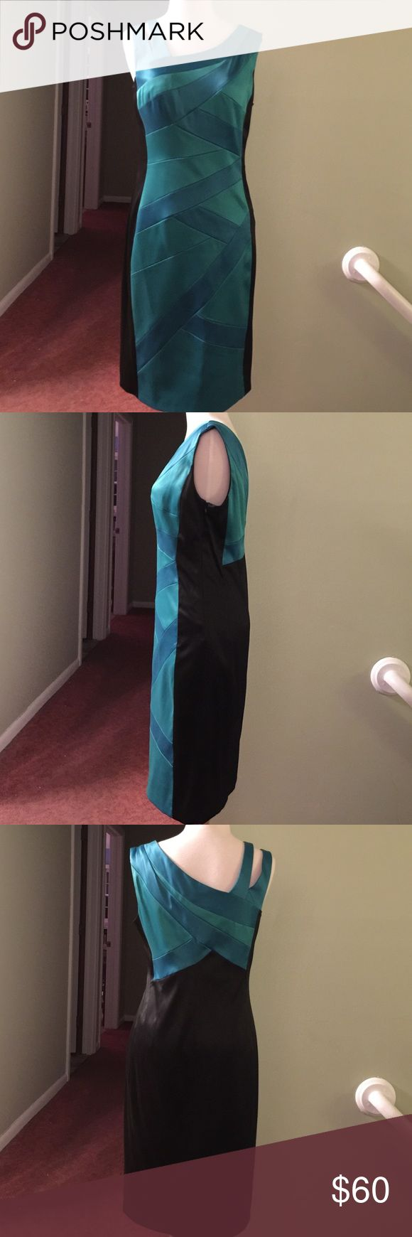 Gorgeous teal formal dress Unique straps / worn once for wedding / black sides add slimming effect / knee length / vibrant colors and excellent condition / zips on left side / longing 100% polyester / she'll 95% polyester 5 % spandex / machine wash cold inside out / gentle cycle / cool iron/ bought at Macy's sangria Dresses Midi