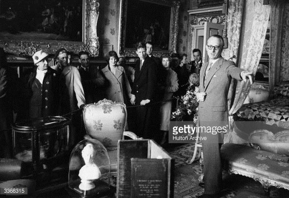 The Duke of Bedford shows the public round a bedroom in Woburn Abbey. Part of a scheme to help the Duke pay off death duties.