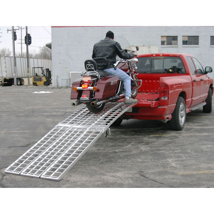 Loading Harley into pickup truck with Big Boy loading ramp