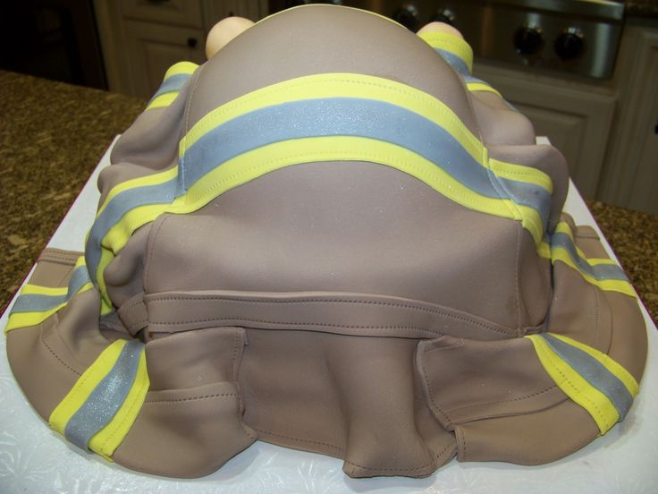 Firefighter Baby Rump Cake Strawberry cake w/ bc icing, covered in fondant. The rump is also cake. Feed and legs are made from AUI...