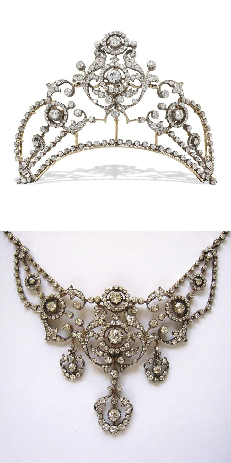 late Victorian diamond necklace, convertable to a tiara, the necklace of ornate openwork foliate and scroll design with graduating cluster motifs, suspending three graduated detachable drops and garland motifs to each side, all to a diamond-set collet chain, set throughout with old brilliant- and old-cut diamonds, estimated to weigh a total of 22 carats, all silver cutdown collet-set to a yellow gold mount, with snap clasp and safety chain, the central section being detachable