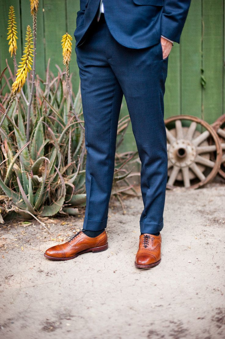 Brown leather shoes are a great way to add some low-key flair to a navy blue suit (or even a tan suit). Def. a style-approved combination. On the other hand, brown suede shoes are a little trickier.