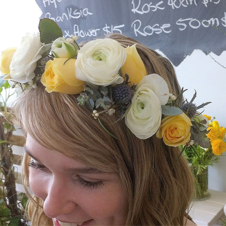 Fresh flower crown 'buttercup' roses, sea holly and double ranunculus.