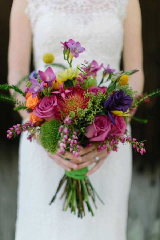 Colorful bridal bouquet | N-Joy! Events and  Carolynn Seibert Photography | see more on: http://burnettsboards.com/2014/08/rustic-neon-wedding-inspiration/