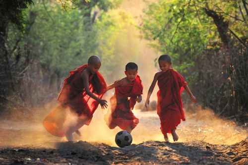 young monks playing soccer