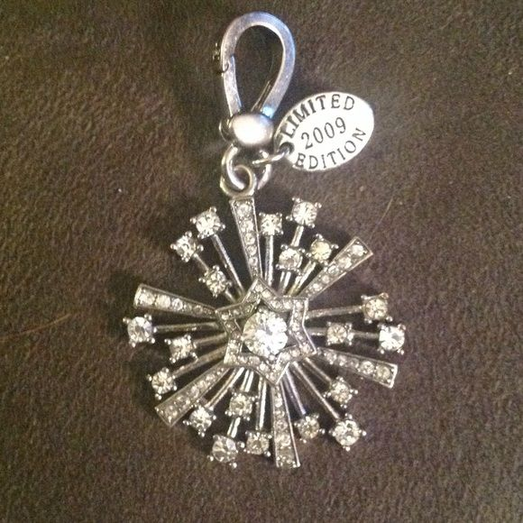 Juicy couture snowflake charm limited edition This is a silver juicy couture 2009 limited edition snow flake charm it is larger than the other snow flake charms and def has a lot of bling Juicy Couture Jewelry