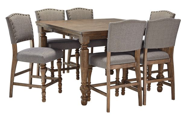 """Perfectly capturing the true beauty of Vintage Casual design, the vintage light gray-brown wire brushed finish of the """"Tanshire"""" dining room collection beautifully complements the vintage black finish of the table base along with the woven gray fabric upholstered chairs with nail head accents to create an inviting collection that enhances the atmosphere of any décor."""