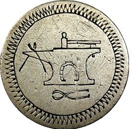 Victorian love token: anvil engraving on a coin.