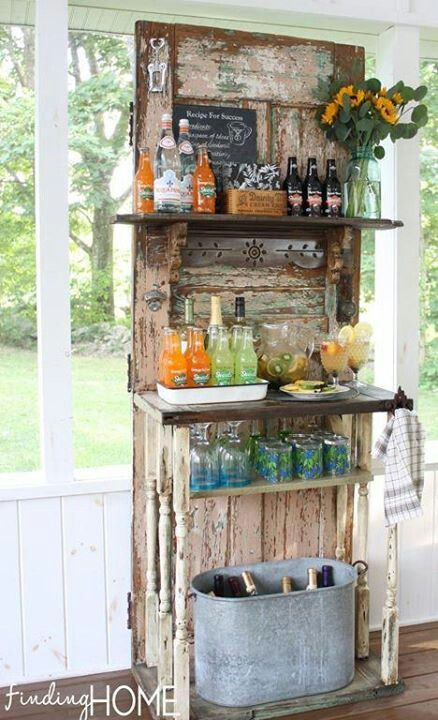 Another perfect use for old door.  Turn it into a rustic drink bar!  This would work for a wedding shower, baby shower, or any party really.  party ideas.  rustic wedding.  vintage wedding.  drink bar. door decor.