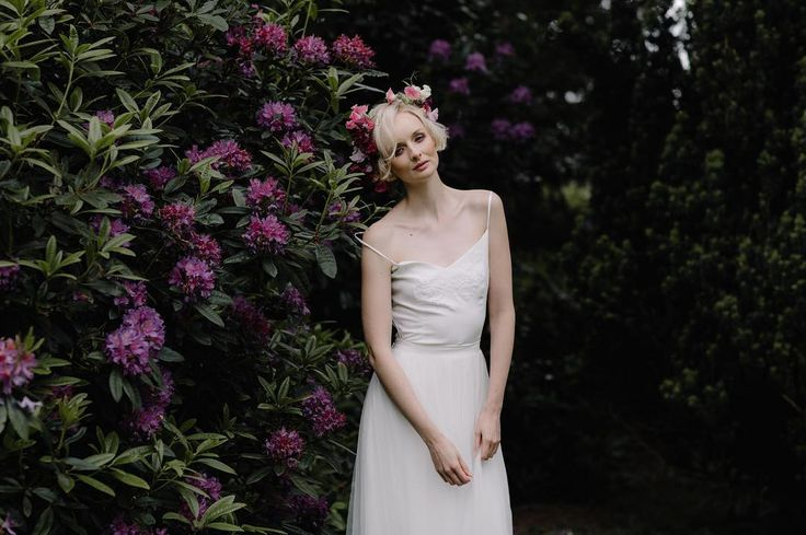 Amongst the rhododendron... Victoria adorned with a sweet pea crown embroidered silk camisole and delicate tulle skirt. If you missed this feature on @lovemydress then click on the link in my bio for the complete look! Kx ______________ Photography: @beccygoddard Venue: @garthmylhall Floral-design: @pheasant_botanica Planning & Styling: @forthelove_of_weddings Stationery: @bymoonandtide & @swann.amy Cake: @swann.amy Silk runners/napkins/ribbons: @pompomblossom Bridalwear: @siennavhildemar…