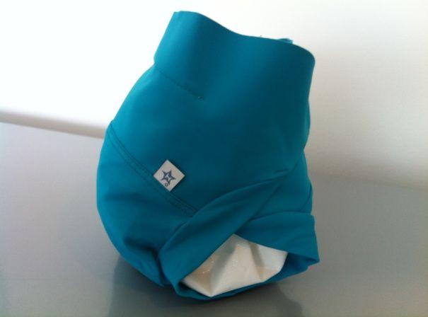 couche lavable turquoise dans le business club de France