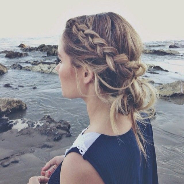 Side braid with a messy bun at the beach