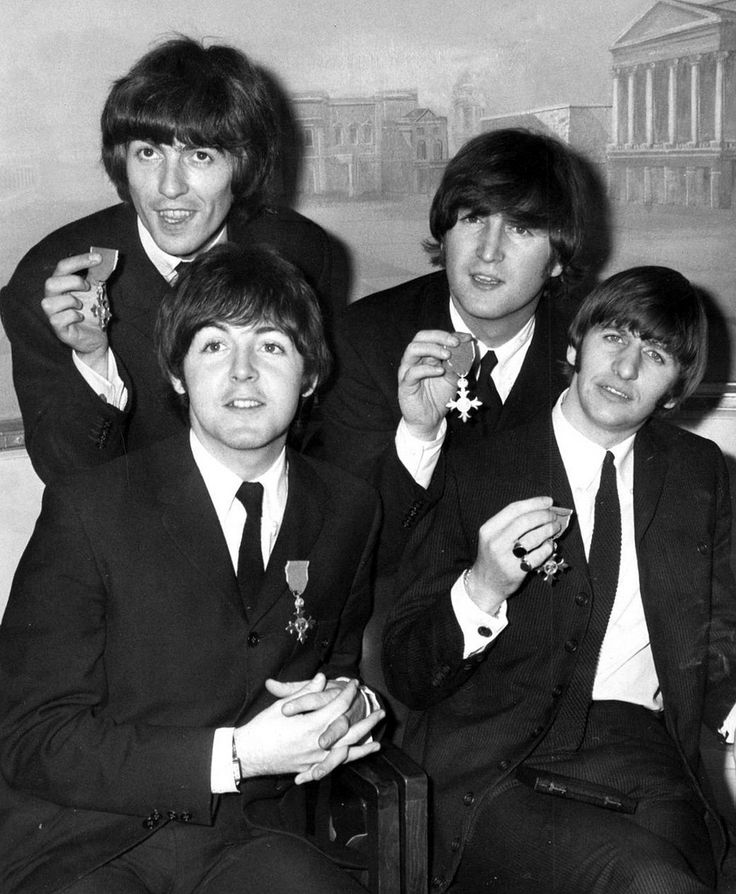 """October 26, 1965 - Queen Elizabeth II invested The Beatles with their MBE's at Buckingham Palace, London. Many former recipients gave their MBE's back in protest, to which John Lennon responded """"Lots of people who complained about us receiving the MBE received theirs for heroism in the war, for killing people."""" He continued: """"We received ours for entertaining other people. I'd say we deserve ours more."""" •• #thebeatles #thisdayinmusic #1960s"""