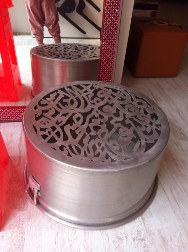 Coffee table as an upside down cooking pot decorated with arabic alphabets! Thats weird but nice. Designer Dina Gildeh