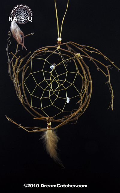 This dreamcatcher is made in the traditional method with natural materials. A delicate hoop made of grape vine with a semi precious stone accenting the web and beautiful feather gracing the bottom of this beautiful piece. The hoop is approximately 4-5 inches in diameter and is approximately 10 to 12 inches long when hung.