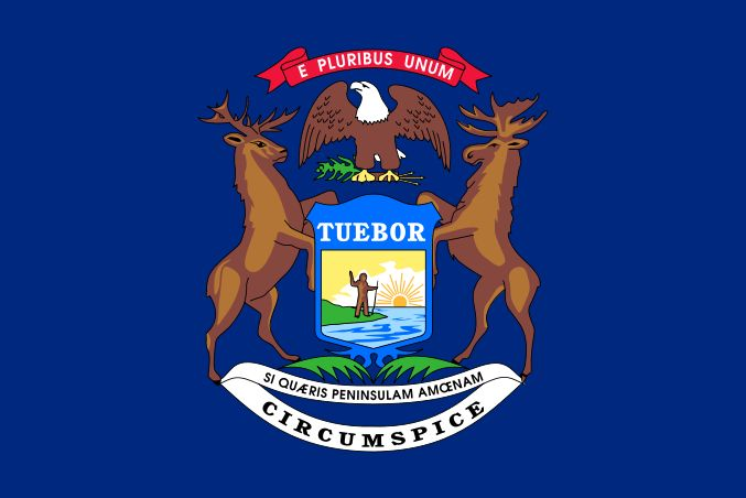 """Illustration: Michigan state flag. Credit: Wikimedia Commons. Read more on the GenealogyBank blog: """"Michigan Archives: 159 Newspapers for Genealogy Research."""" https://blog.genealogybank.com/michigan-archives-159-newspapers-for-genealogy-research.html"""