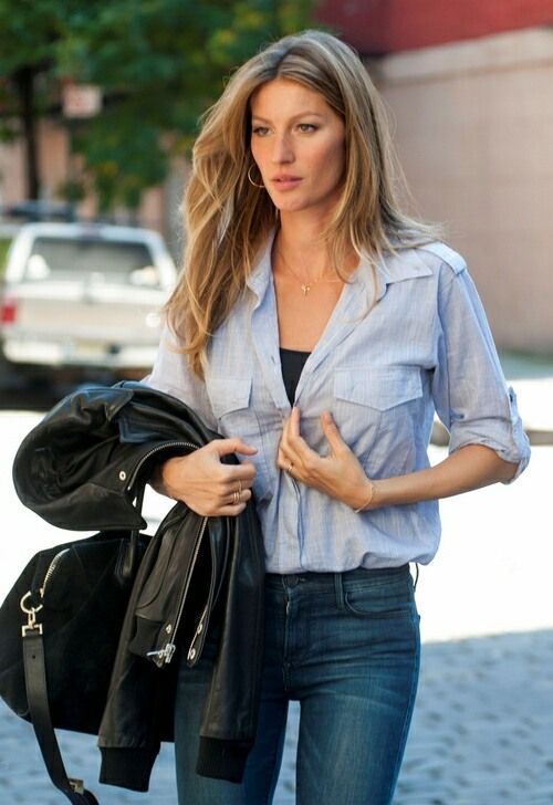 Womens Street style fashion: Model Gisele Bunchen denim jeans blue shirt black leather motorcycle jacket casual chic