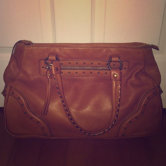 Michael Kors Camel Bag Like new on the outside! A little bit of discoloration on the inside but not noticeable to the untrained eye. Large size, great work or every day bag. Real Michael Kors and real leather. Michael Kors Bags Totes