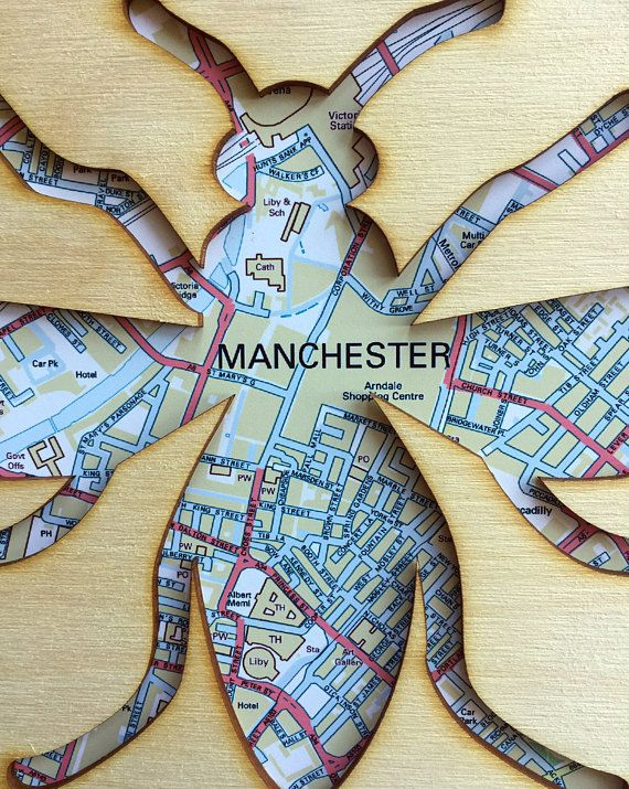 This striking Manchester Map Bee lasercut wall art is a must have for lovers of modern Manchester, and its rich industrial history. The worker bee was adopted as a motif for Manchester during the Industrial Revolution  This contemporary wall art, combines a lasercut plywood bee cut out, with a central Manchester map print behind and measures 23cm x 23cm  Please note, this lasercut product is NOT framed.  The photograph shows an Ikea Ribba Frame, available in black or white so you can…
