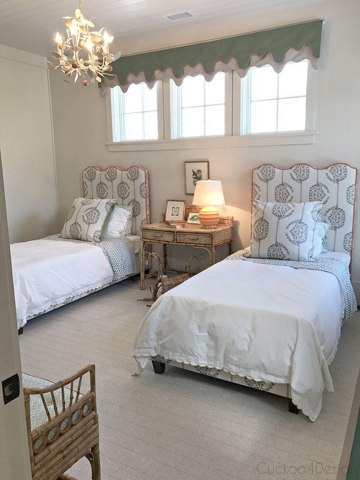 kids bedroom with upholstered headboard, orange trim and vintage wicker furniture   guest bedroom   whimsical vintage decor