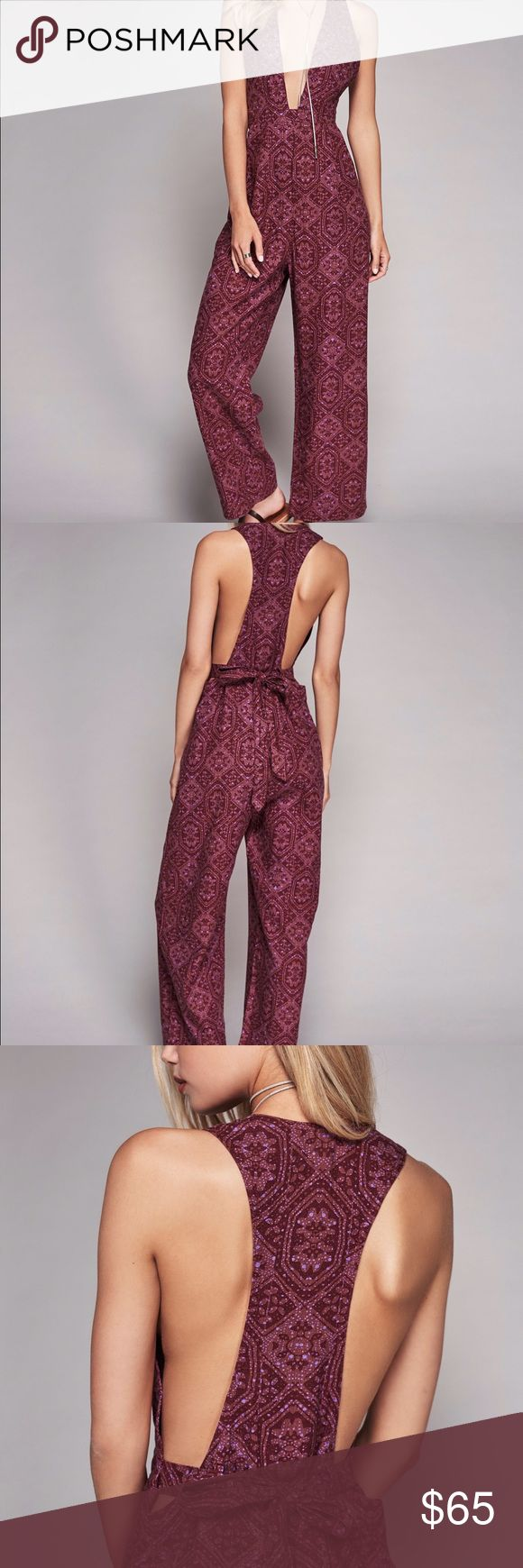 Free people my kind of woman one piece berry combo Printed one piece featuring a plunging V-neckline and a racerback with an adjustable tie in back. Wide legs with pleating around the waistband. Hidden side zip closure.  55% Linen 45% Rayon Machine Wash Cold Import Free People Pants Jumpsuits & Rompers