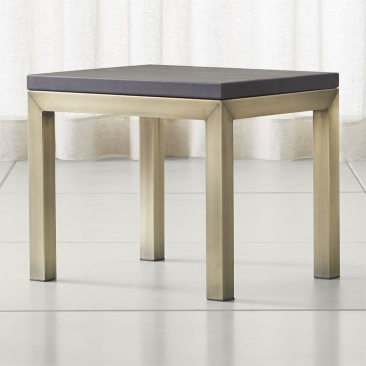 Shop Parsons Pine Top/ Brass Base 20x24 End Table.   Harvested from European spruce that's been certified sustainable by the Forest Stewardship Council, the table's rustic tabletop is wire-brushed to bring out the wood's natural grain.