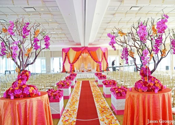 The floral and decor at the Indian wedding ceremony. The beautiful colorful, fabric draped mandap.