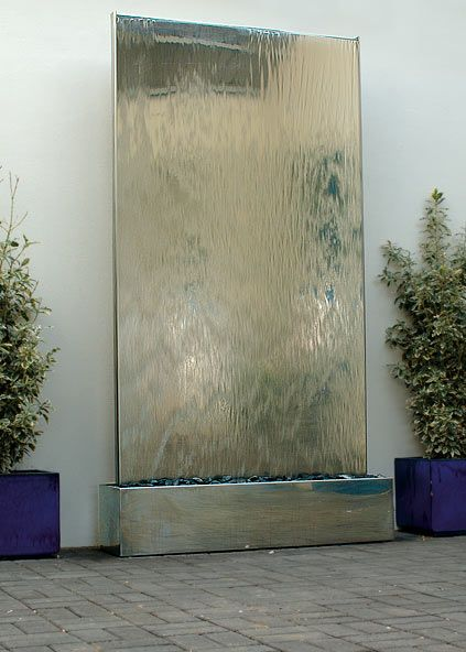 Water Wall in Stainless Steel: Self-contained Water Feature. David Harber, UK - I think this type of water feature is beginning to look a bit out of date.
