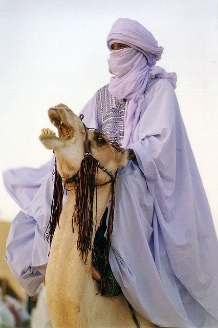 Tuareg man in the Sahara Desert, Libya. The Tuareg are Berber people with a traditionally nomadic pastoralist lifestyle.