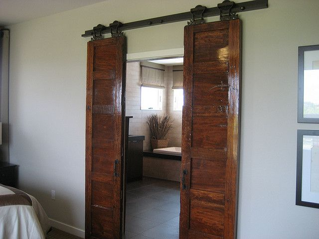 I wish we had room for a sliding door system like this in our tiny house!  Im in love with a door if that is possible...